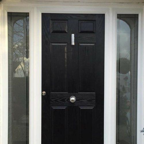 6 Panel Black Composite Door With Sandblasted Sidelights.